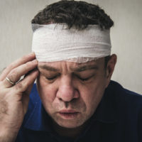 Man with a concussion.jpg.crdownload