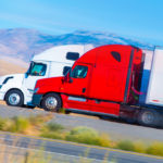 Two Tractor trailer trucks.jpg.crdownload