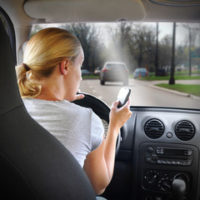 Girl driving Distracted