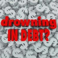 drowning in debt sign