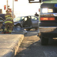 Firefighters present in the remains of a car crash