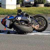 Remains of a blue motorcycle after an accident