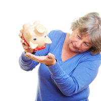 lady with empty piggy bank