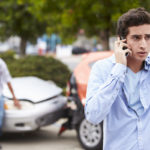 Teenage Driver Making Phone Call After Car Accident