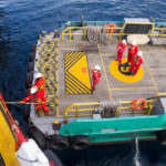 Maritime workers are transported on a vessel to offshore rigs in The South China Sea