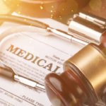 Medical malpractice forms, wooden gavel and stethoscope, close-up view
