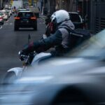 A motorcycle courier riding in the city
